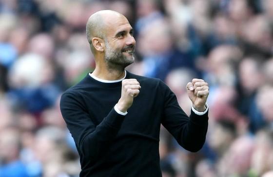 HLV Pep Guardiola giờ có thể tập trung tối đa để lên kế hoạch bảo vệ danh hiệu. Ảnh: Getty Images
