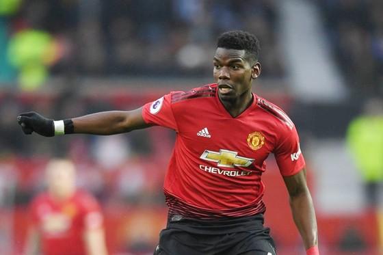 Paul Pogba vẫn đang cố gây sức ép để ra đi. Ảnh: Getty Images