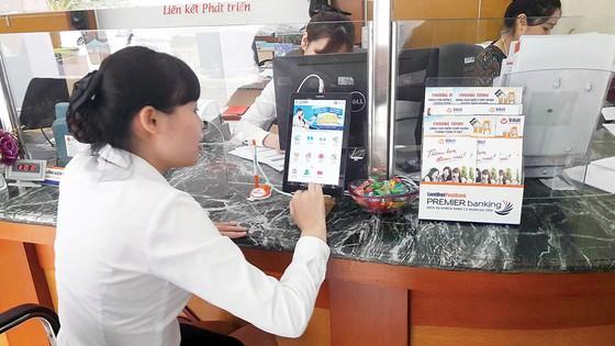 LienVietPostBank tiên phong dùng máy tính bảng giới thiệu sản phẩm tới khách hàng ảnh 1