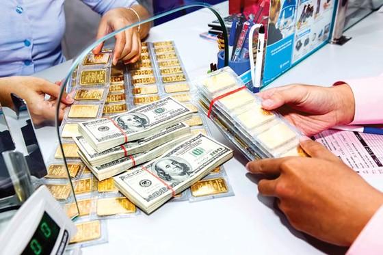 Vàng, USD phản ứng chậm với giá thế giới ảnh 1