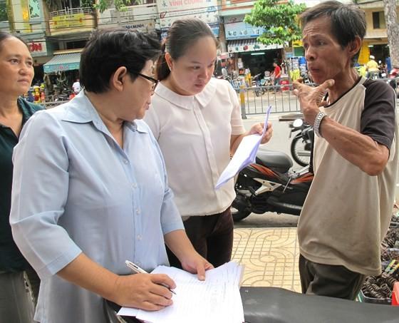 Công bố quận 5 không còn hộ nghèo theo chuẩn TPHCM ảnh 1
