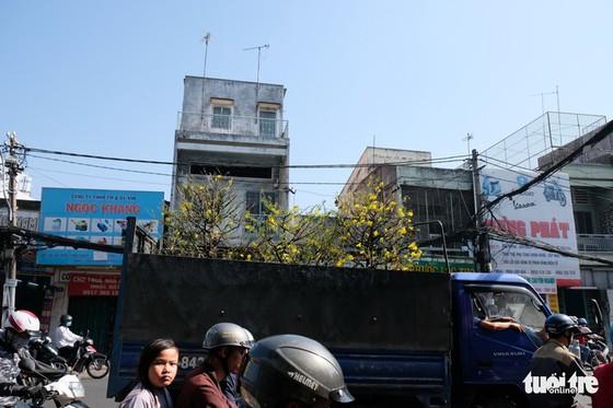 Màu tết rực rỡ tràn ngập phố Sài Gòn - Ảnh 8.