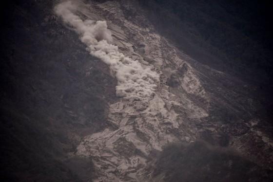 Hình ảnh tang thương khi núi lửa phun giết hàng chục người ở Guatemala - Ảnh 18.