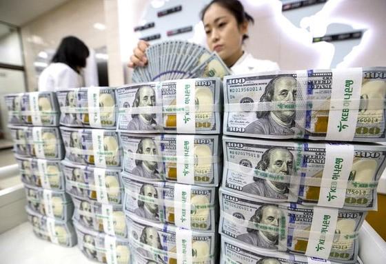Thách thức vị thế đồng USD ảnh 1