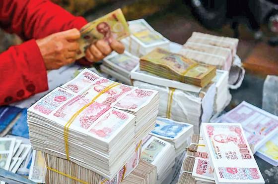 Luật cấm đổi tiền lẻ, tiền mới  ảnh 1