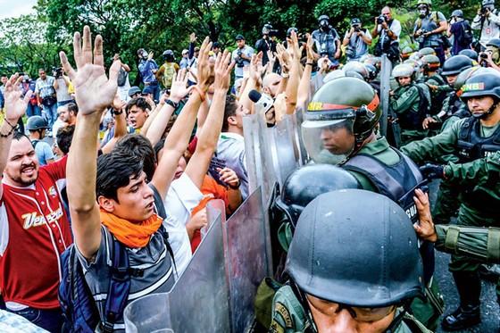 Venezuela - Đường đến khủng hoảng - Kỳ 3: Dẫn đầu chỉ số khốn khổ ảnh 1
