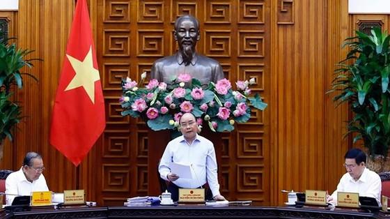 Thủ tướng Nguyễn Xuân Phúc chủ trì cuộc làm việc của Thường trực Tiểu ban Kinh tế - Xã hội Đại hội đại biểu toàn quốc lần thứ 13 của Đảng. Ảnh: TTXVN