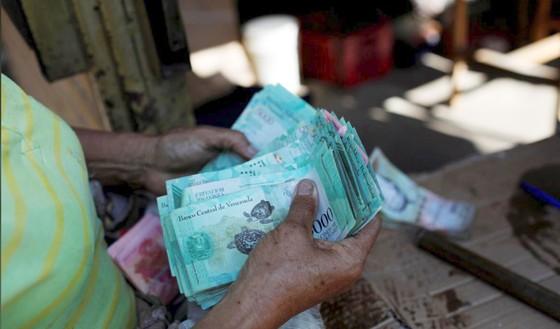Venezuela loại đồng USD khỏi thị trường hối đoái ảnh 1