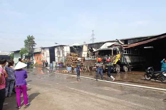Cháy kho hàng ở huyện Hóc Môn, nhiều tài sản bị thiêu rụi ảnh 6