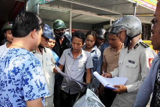 Đà Nẵng tiến hành tháo dỡ các ki-ốt kinh doanh bất động sản trái phép ảnh 2