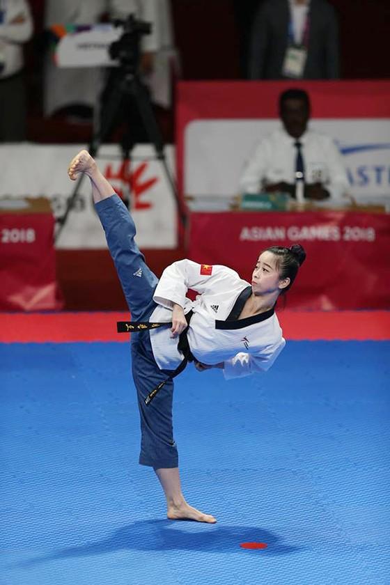 Taekwondo: Đồng đội nam vào bán kết, Châu Tuyết Vân thua VĐV chủ nhà ảnh 3