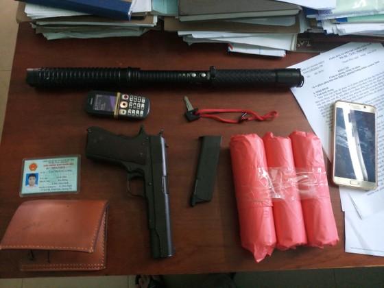 Quảng Bình: Khởi tố vụ vác súng đi cướp quỹ tín dụng nhân dân xã ảnh 1