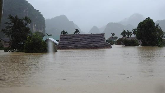 Mưa lớn, lũ dâng ngập Tân Hóa vượt mốc năm 2016 ảnh 12