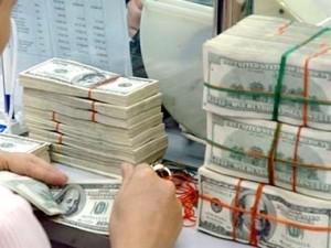 Ngân hàng Nhà nước tăng tỷ giá liên ngân hàng ảnh 1