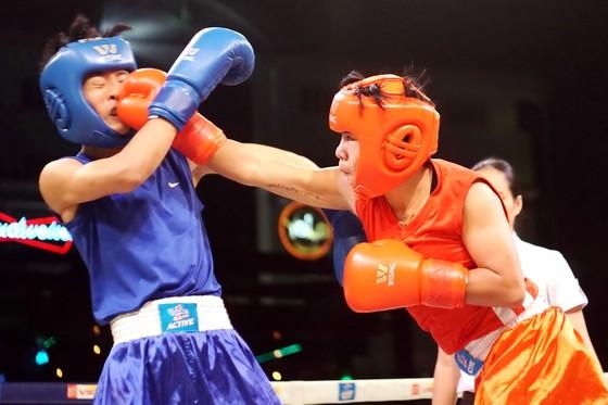 Thu Nhi (áo đỏ), vô địch hạng cân -48kg. Ảnh: ANH TRẦN