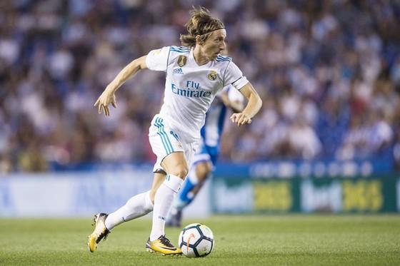 Modric cần thách thức lớn hơn mới rời Tottenham. Ảnh: Getty Images