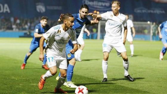 Real (trắng) có chiến thắng trước Fuenlabrada. Ảnh: Getty Images