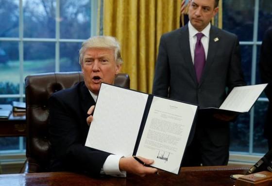 Mỹ hoàn tất thủ tục rút khỏi TPP ảnh 1
