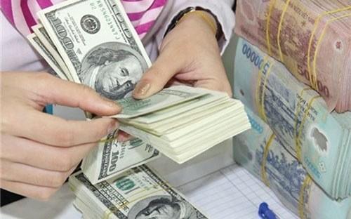 NHNN mua vào 7,7 tỷ USD trong 3 tháng ảnh 1