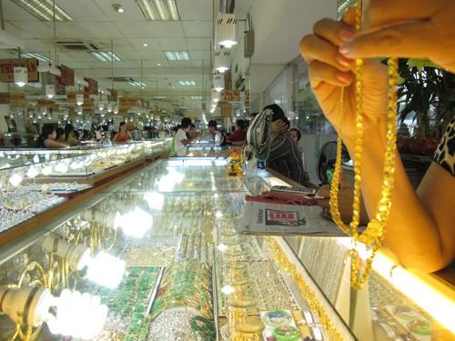 Giá vàng giảm nhẹ về 35,38 triệu đồng/lượng ảnh 1