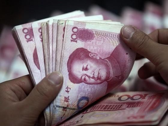 Trung Quốc giảm tỷ giá thêm 1,6% ảnh 1