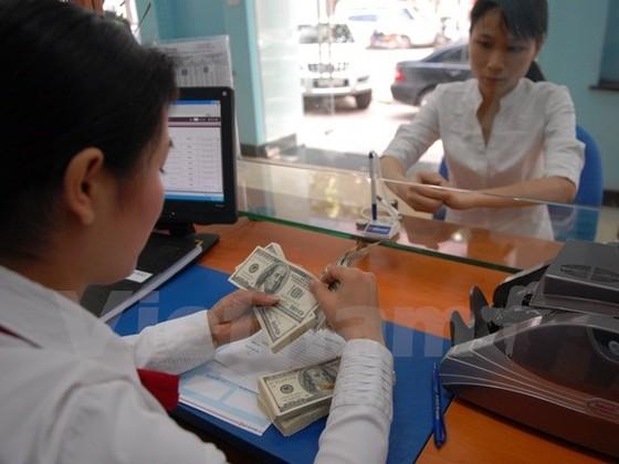 Giá USD tăng 110 đồng so với buổi sáng ảnh 1