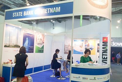 Eximbank dự Hội nghị tài chính 2015 tại Singapore ảnh 1