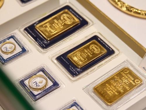 Giá vàng SJC giảm, USD tăng nhẹ ảnh 1
