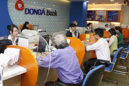 NHNN đình chỉ và thay thế 2 lãnh đạo DongABank ảnh 1
