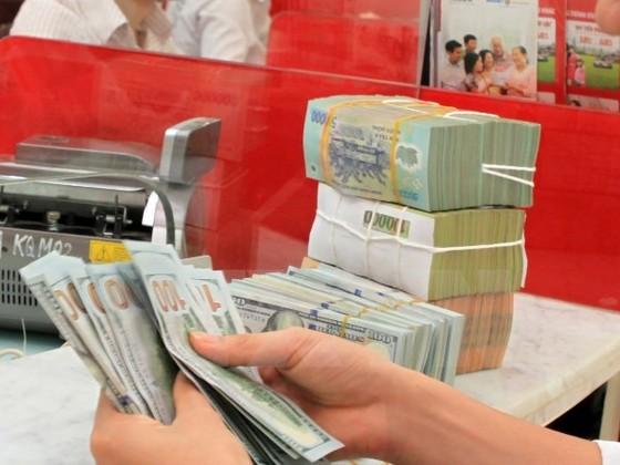 Giá mua USD áp sát trần: NHNN sẽ làm gì? ảnh 1