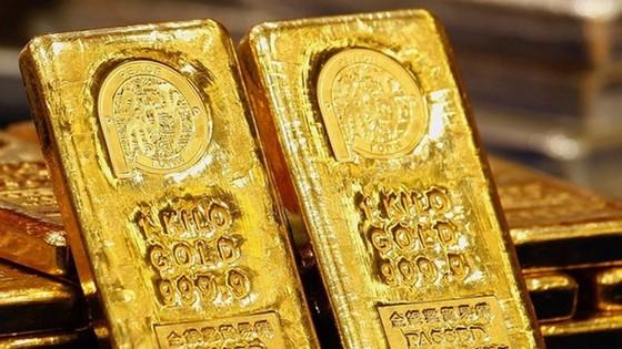 Vàng sẽ giảm gần 10% trong năm 2015 ảnh 1