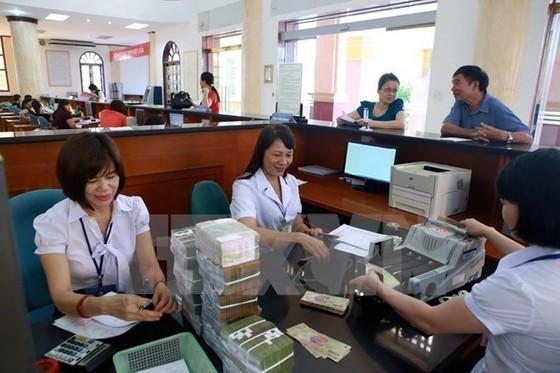 Nhiều khoản thu ngân sách ủy nhiệm cho ngân hàng ảnh 1