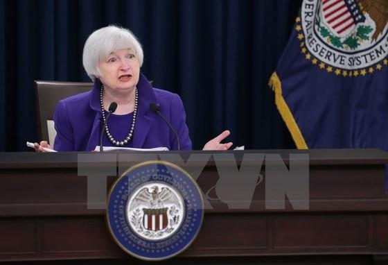 Fed giữ lãi suất và hạ dự báo triển vọng kinh tế ảnh 1