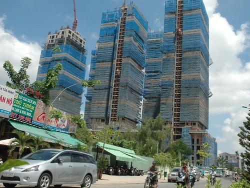 Sóng ngầm bán tháo các dự án bất động sản ảnh 1