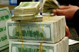 Từ 1-7 DNNN phải bán ngoại tệ cho ngân hàng ảnh 1