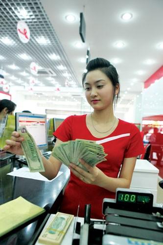 NHNN liên tục nâng tỷ giá USD ảnh 1