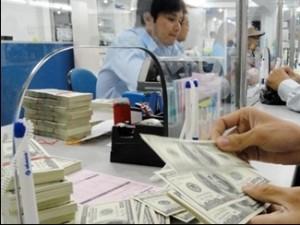 Ngân hàng thương mại tăng giá mua USD ảnh 1