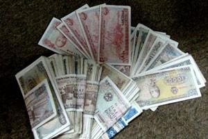 Tiền mệnh giá thấp ngày càng vắng bóng ảnh 1