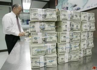 77.000 ngân hàng toàn cầu chống trốn thuế ảnh 1