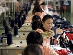 Trung Quốc điều chỉnh tăng trưởng kinh tế ảnh 1