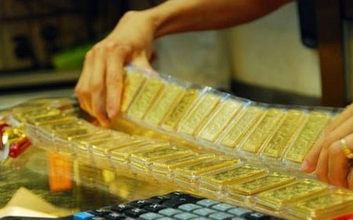 Giao dịch vàng 300 triệu đồng phải báo cáo ảnh 1
