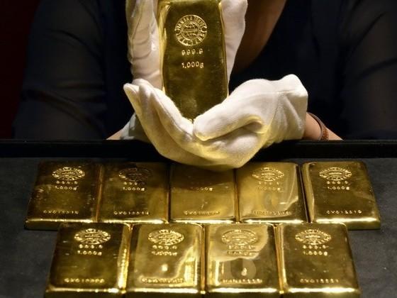 Giá vàng giảm trở lại ảnh 1