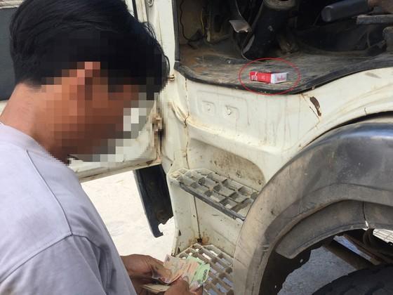 Xe cũ nát lọt 'lỗ kim' đăng kiểm - ảnh 1