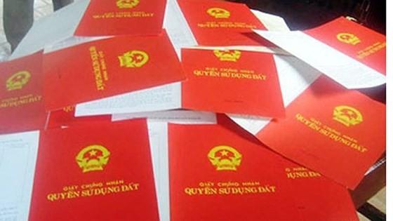 Ngưng hiệu lực quy định ghi tên tất cả thành viên gia đình vào sổ đỏ ảnh 1