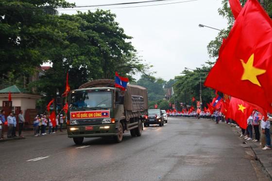 An táng 12 hài cốt liệt sĩ hy sinh trên đất bạn Lào ảnh 1
