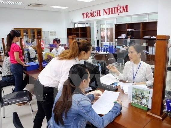 A pilot selection of leaders and managers at department and division levels will be conducted in 14 ministries and 22 provinces and cities nation-wide. (Photo: VNA)