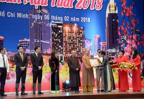 A number of individuals with outstanding contributions to the city's development were honoured at the event (Photo: VNA)