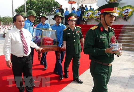 Quang Binh holds reburial service for remains of martyrs