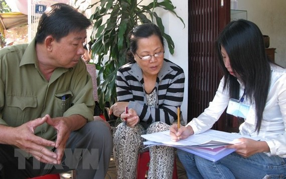 Investigator makes survey at a household (Source: VNA)