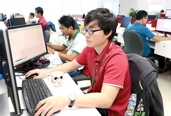 Software programmers work in Quang Trung Software City. Photo by Viet Dung